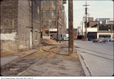 File consists of 148 photographs and 5 urban development plans depicting King Street West and Spadina Avenue.
